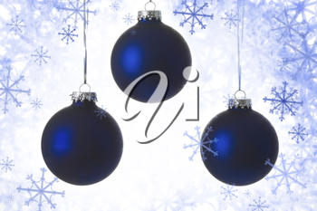 Close-up of three blue balls over Christmas background