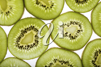 Close-up of several parts of kiwi on a white background