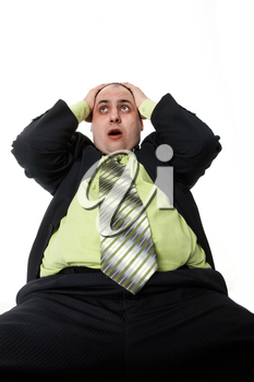Photo of astonished businessman touching his head