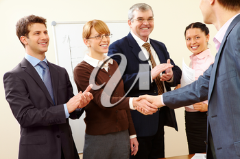 Image of successful handshake after business training
