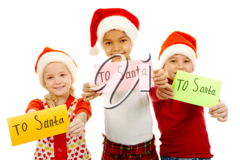 Three children holding their letters with note �To Santa�