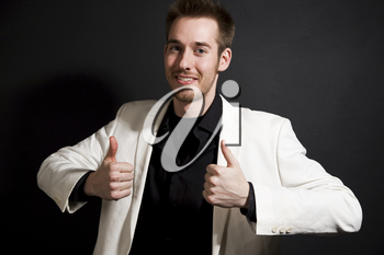 A shot of a casual caucasian businessman giving two thumbs up