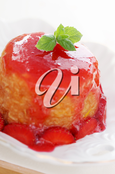Summer dessert with apples oranges and strawberries
