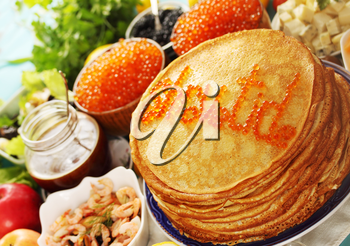 large stack of pancakes with different fillings