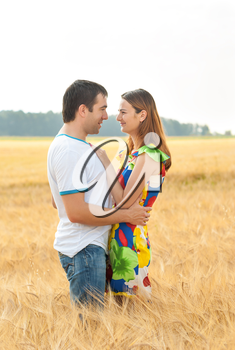 Attractive young couple hugging outdoors.