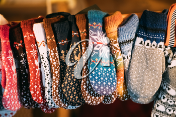 Close View Of Various Colorful Knitted Traditional European Warm Clothes - Mittens At Winter Christmas Market. Souvenir From Europe.