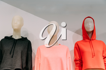 Close View Of Mannequins Dressed In Female Woman Casual Clothes In Store Of Shopping Center.
