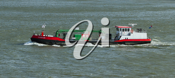 ROTTERDAM, THE NETHERLANDS - JUNE 22: Small chemical tanker sailing in the port of Rotterdam (Holland), Rotterdam, June 22, 2012