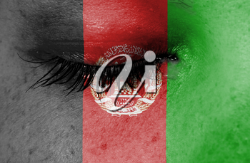 Crying woman, pain and grief concept, flag of Afghanistan