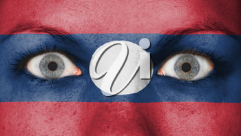 Close up of eyes. Painted face with flag of Laos