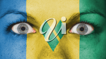 Close up of eyes. Painted face with flag of Saint Vincent and the Grenadines