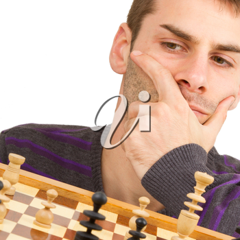 Chessboard with desperate man thinking about chess strategy, isolated on white