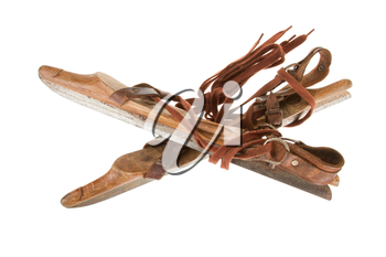 Old wooden ice skates isolated on white