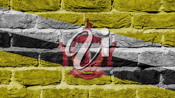 Very old brick wall texture, flag of Brunei
