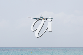 Unrecognisable airplane landing on the Caribbean isle of Saint Martin