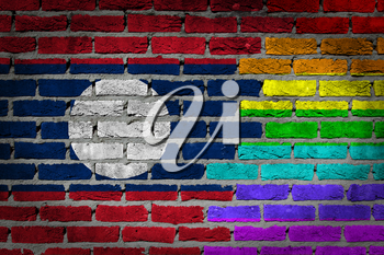 Dark brick wall texture - coutry flag and rainbow flag painted on wall - Laos