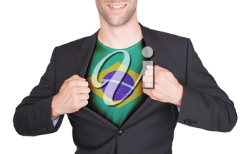 Businessman opening suit to reveal shirt with flag, Brazil
