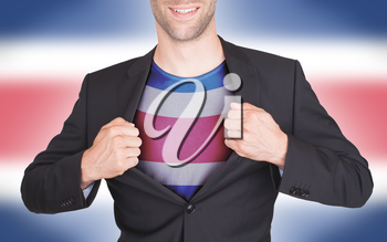 Businessman opening suit to reveal shirt with flag, Costa Rica