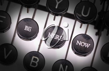Typewriter with special buttons, be here now