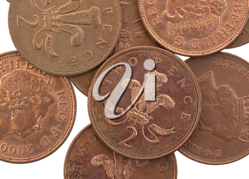 Two Pence coins isolated over a white background, selective focus
