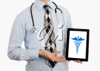 Doctor holding tablet, isolated on white - Caduceus symbol