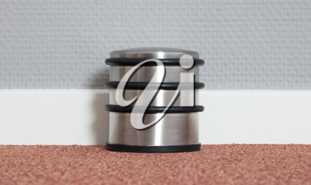 Dusty doorstop in a modern house, selective focus