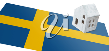 Small house on a flag - Living or migrating to Sweden