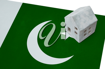 Small house on a flag - Living or migrating to Pakistan