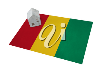 Small house on a flag - Living or migrating to Guinea