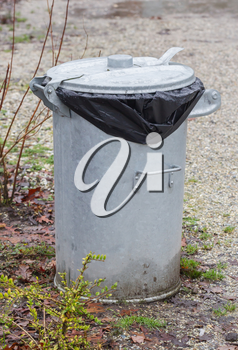 Metal rubbish bin in a park - the Netherlands
