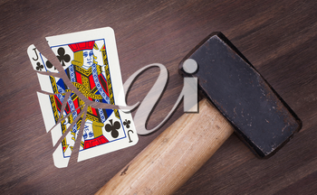 Hammer with a broken card, vintage look, jack of clubs