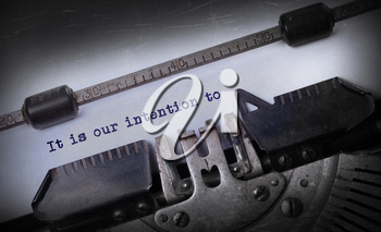 Vintage inscription made by old typewriter, It is our intention to