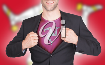 Businessman opening suit to reveal shirt with flag, Isle of Man