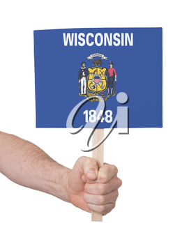 Hand holding small card, isolated on white - Flag of Wisconsin