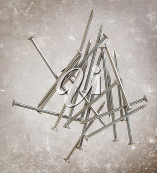 Many metal nails on a vintage background