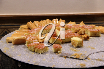 Pieces of cakes. Eating fresh sweet cakes in restaurant. Sweet cakes on salver with spatula. Slice of sweet dessert close up