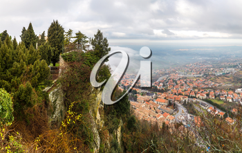 Panoramic aerial view of San Marino in foggy winter day