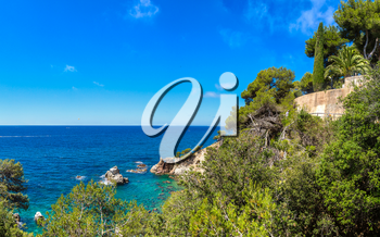 Panorama of Rocks on the coast of Lloret de Mar in a beautiful summer day, Costa Brava, Catalonia, Spain