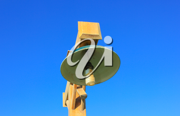 Wooden striit lamp on blue sky background