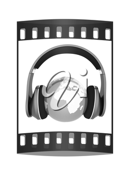 earth with headphones. World music concept isolated on white. The film strip