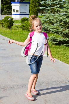 Cute girl go to school with pink knapsack