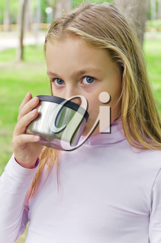 Cute girl with long hair drinking beverage