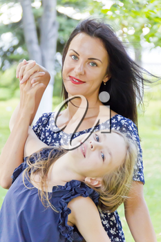 Playing mother and daughter in summer on green background