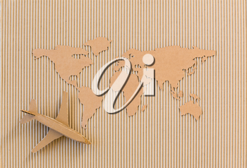 Airplane and world map made of cardboard. Worldwide delivery concept.
