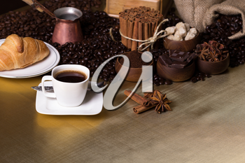 Still-life with coffee, coffee beans and spices. Coffee time concept