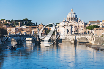 view on Tiber river and St Peter Basilica in Rome
