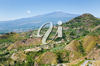 view on Etna and agricultural gardens on flank of hills in Sicily