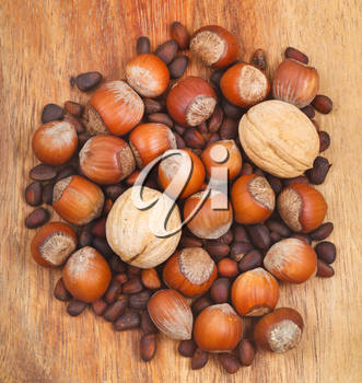 many dried nuts on wooden board