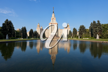 panoramic view of main building of Moscow State University and fountain pond in summer day