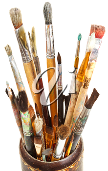 many used artistic paintbrushes in wooden cup isolated on white background